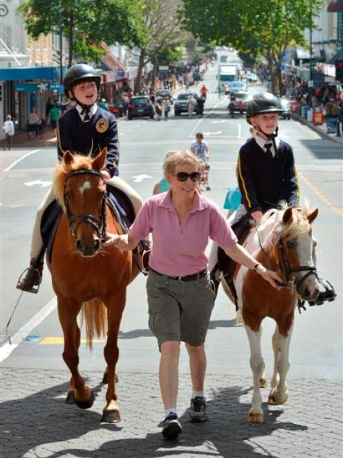 Taking part in the Ride The Rhythm street parade in Dunedin yesterday are (from left) Katelyn...
