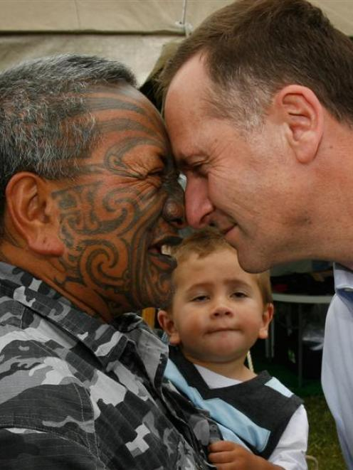 Tame Iti with his grandson Te Rangimoaho (20mths) meet National Party Leader John Key on the...