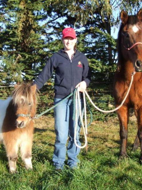 Tara McConnell at home at Flag Swamp with Laddie and Trixie. Photo by Sally Rae.
