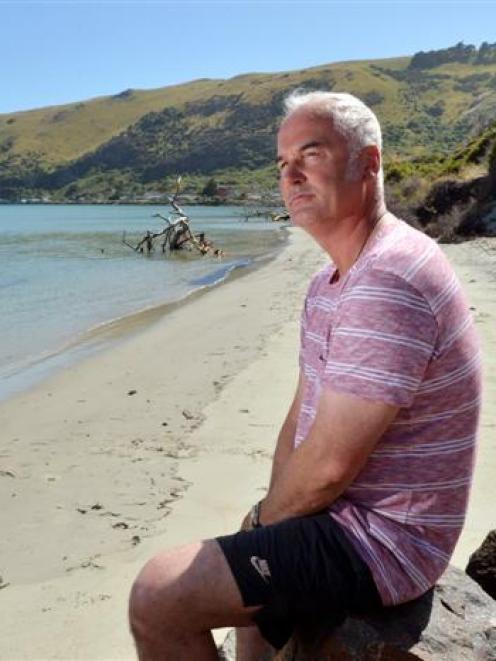 Te Rauone Coastal Care Group chairman Hoani Langsbury on Te Raone Beach which is crumbling into...
