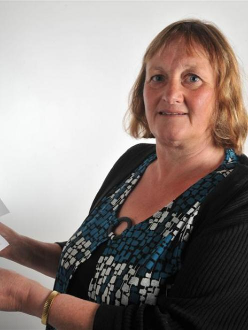 Teacher Ruth Baldwin holds a pamphlet she has written to raise awareness about the Alpine Fault...