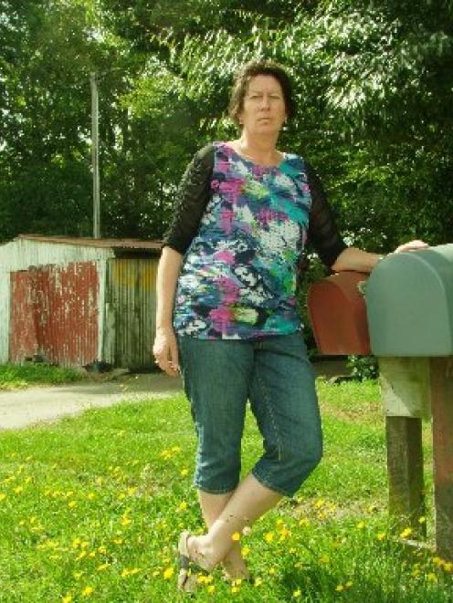 Teacher Sarah Roberts outside her family farm. Photo by Chris Morris.