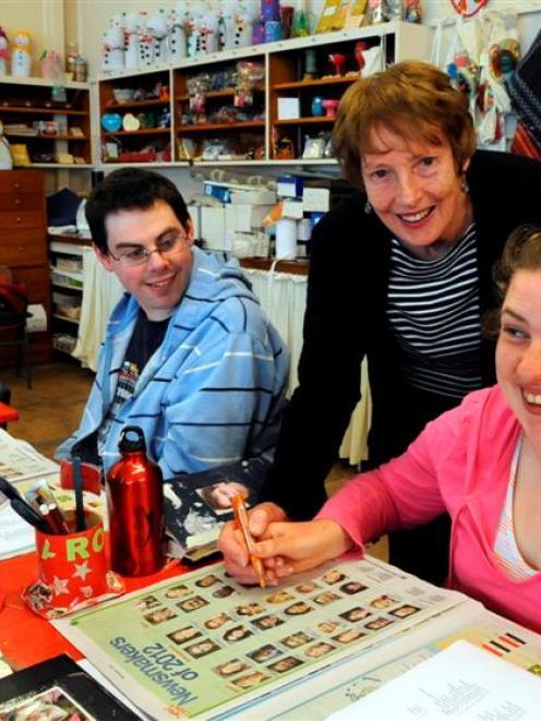 Teacher Trudy Scott helps Aaron Williams (30), of Mosgiel, and Meghan McNeill (23), of Dunedin,...