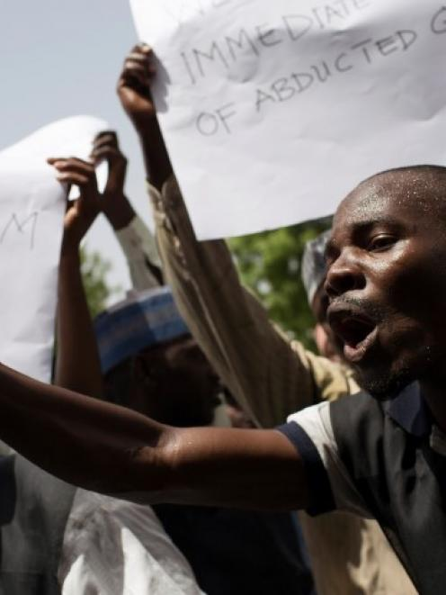 Teachers take part in a rally to call for the release of abducted schoolgirls held by Boko Haram...
