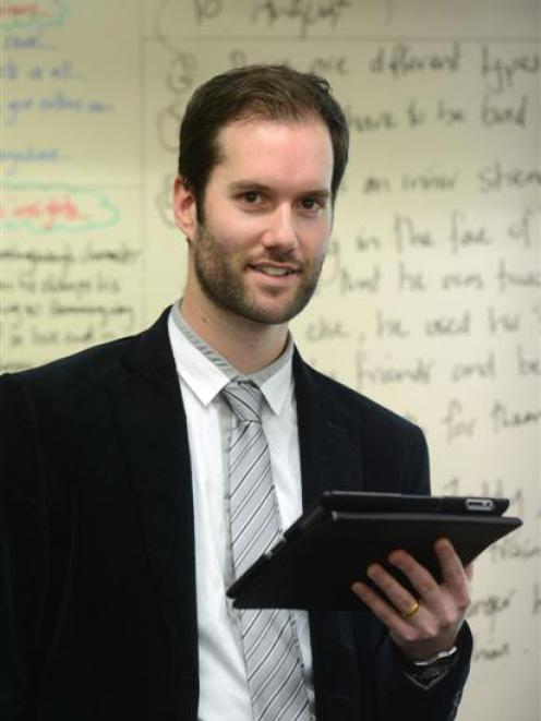 Tech-using teacher Konrad Hanson puts lesson plans, including film clips and other resources, on...
