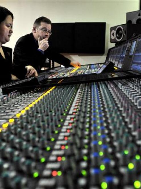 Technicians Stephen Stedman and Lou Kewene operate the desk at the NZMiC Albany St studio.Photo...