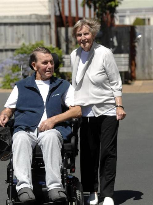 Ted and Heather Turner, formerly of Palmerston, at home in St Kilda are behind the Neurological...