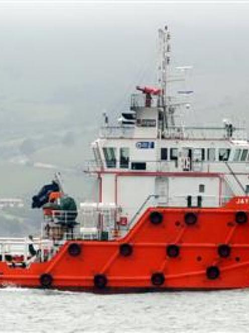 Tender supply vessel Jaya Amazon dwarfs tourist boat Monarch on Otago Harbour yesterday, ahead of...