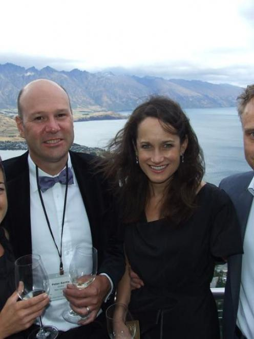 Terra Sancta owners Sarah Eliott and Mark Weldon (right) with winemaker Peter Bartle (second from...