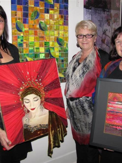 Textile artist Karyn Hitchman, of Queenstown, (left) holds her best local art award-winning work,...