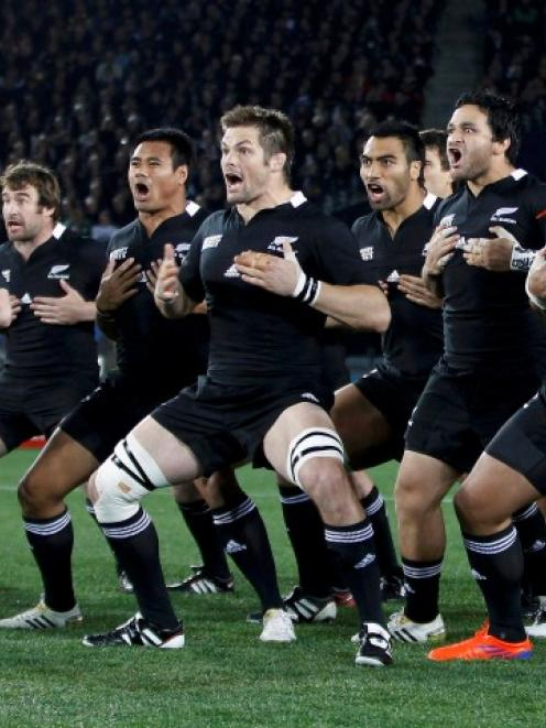 The All Blacks have led the march of the top-seeded teams into the Rugby world Cup quarterfinals....