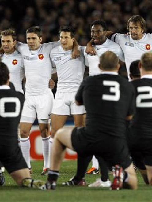 The All Blacks perform the haka as the French team approaches. (AP Photo/Christophe Ena)