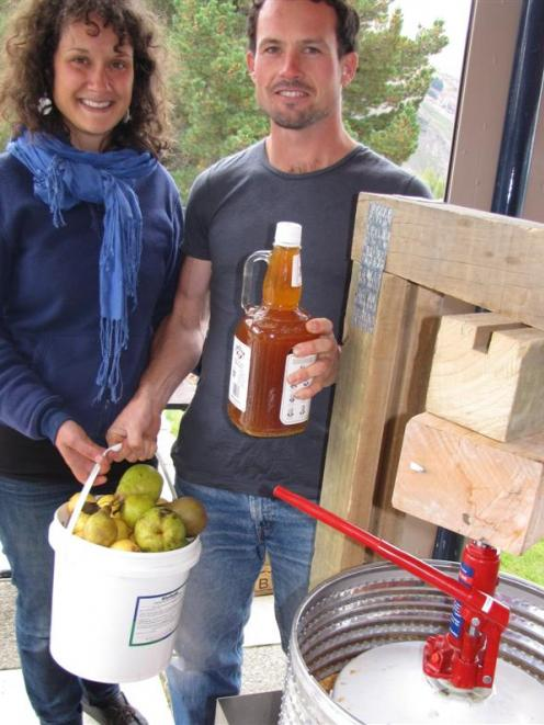 The apple press made from recycled objects by Robbie Lawton, pictured with Christine Rozon (both...