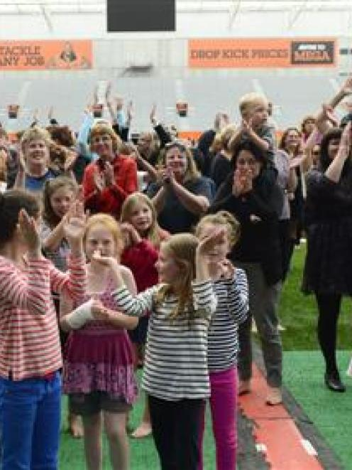 The appreciative crowd applaud group Anika Boh & Hollie at Forsyth Barr Stadium last night....