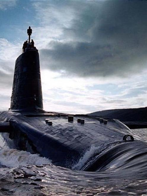 The British Navy's HMS <i>Victorious</i>, a Trident ballistic missile submarine, in the Clyde...