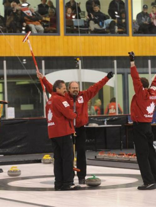 The Canadian men's team celebrates the gold medal at the Dunedin Ice Stadium on Saturday....