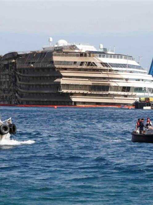 The capsized cruise liner Costa Concordia was raised in a 19-hour operation.  REUTERS/Tony Gentile