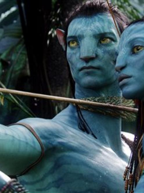 The character Neytiri, voiced by Zoe Saldana, right, and the character Jake, voiced by Sam...