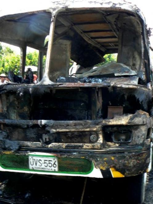 The charred remains of the bus after the fire. REUTERS/Stringer