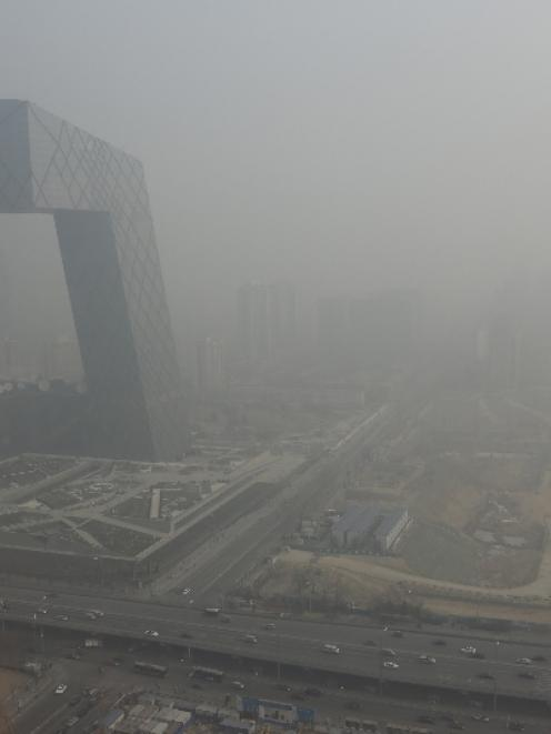 The China Central Television (CCTV) building is seen next to a construction site in heavy haze in...