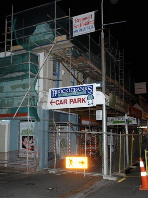 The closed and scaffolded building in South Dunedin last night. Photo by Linda Robertson.