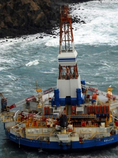The conical drilling unit Kulluk sits grounded 64km southwest of Kodiak City, Alaska earlier this...