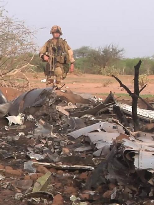 The crash site of Air Algerie flight AH5017 is seen near the northern Mali town of Gossi. Photo...