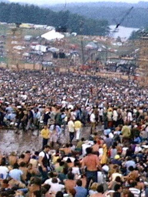 The crowd at Woodstock fills a natural amphitheatre with the stage at the bottom. Photo by Derek...
