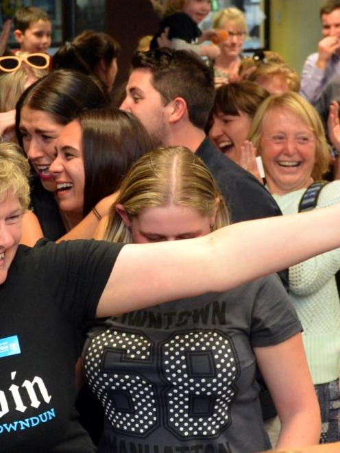 The crowd celebrates at the Dunedin Gigatown office. Photo by Peter McIntosh