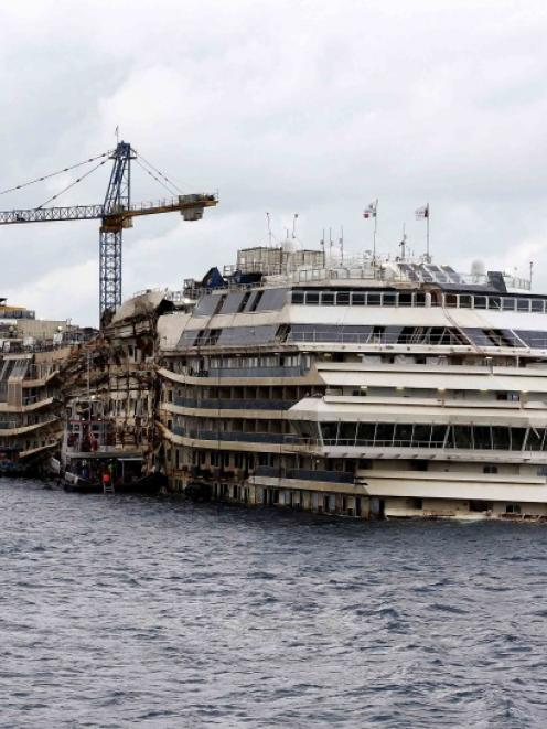 The cruise liner Costa Concordia is seen outside Giglio harbour in this February 26 file photo....