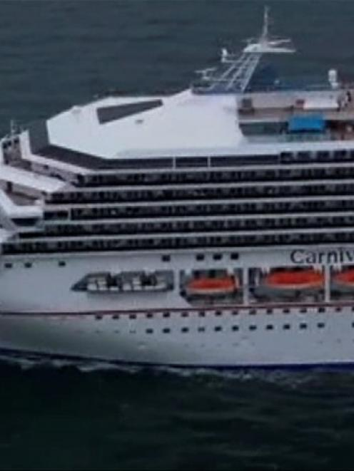 The cruise ship Carnival Triumph cruise ship is towed in this video frame grab from NBC News...