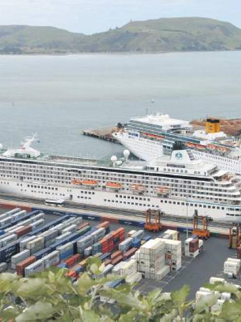 The cruise ships Voyager of the Seas and Crystal Symphony (rear) berthed at Port Chalmers in 2012...