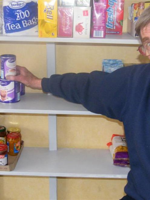 The cupboard is bare: Gore Salvation Army social worker Tom Banks surveys the empty spaces on the...