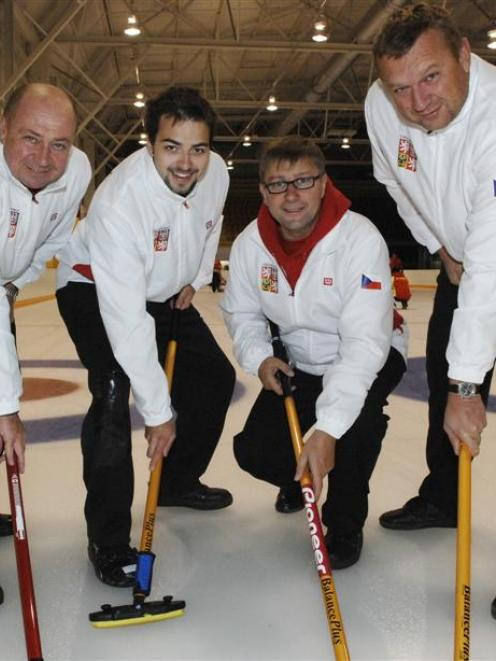 The Czech Republic curling team trains at the Dunedin Ice Stadium yesterday. From left are Zdenek...