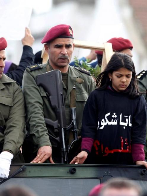 The daughter of assassinated prominent Tunisian opposition politician Chokri Belaid takes part in...