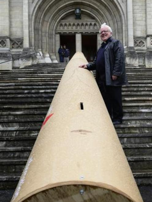 The  Dean of St Paul's,  the Very Rev Dr Trevor James, with a 16m cardboard tube outside St Paul...