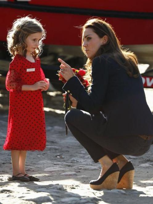 The Duchess of Cambridge receives a bouquet of flowers from Maggie Langford after the jet-boat...
