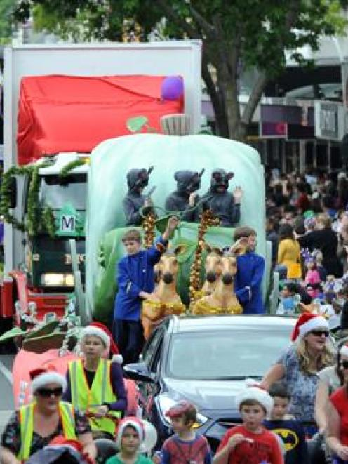 The Dunedin Santa Parade makes its way down George St yesterday. Photo by Craig Baxter.