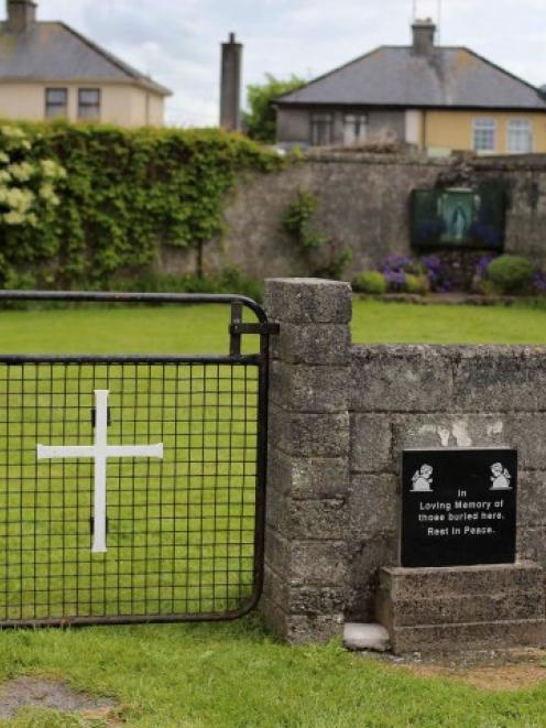 The entrance to the site of a mass grave of hundreds of children who died in the former Bons...