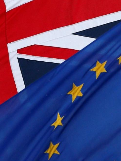 The EU and the Union flags fly outside The European Commission Representation in the United...
