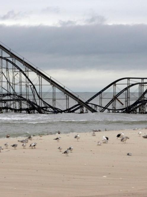The extensive damage to an amusement park roller coaster in the aftermath of Hurricane Sandy is...