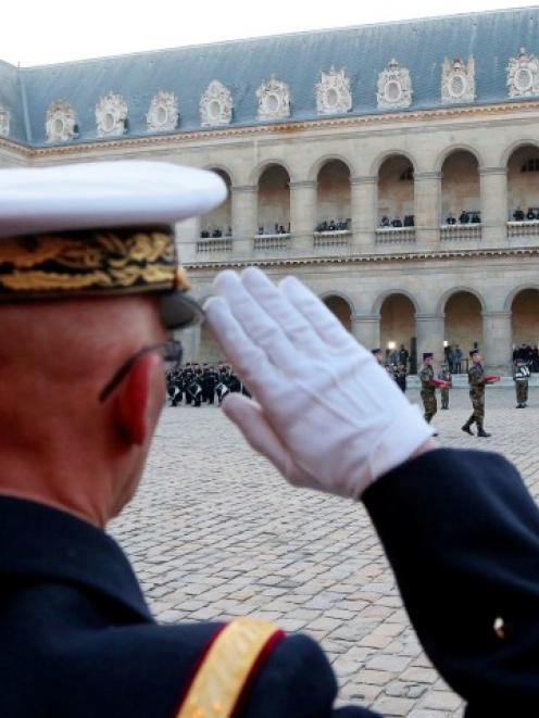 The flag-draped coffin of French lieutenant Damien Boiteux, who was killed during the French...