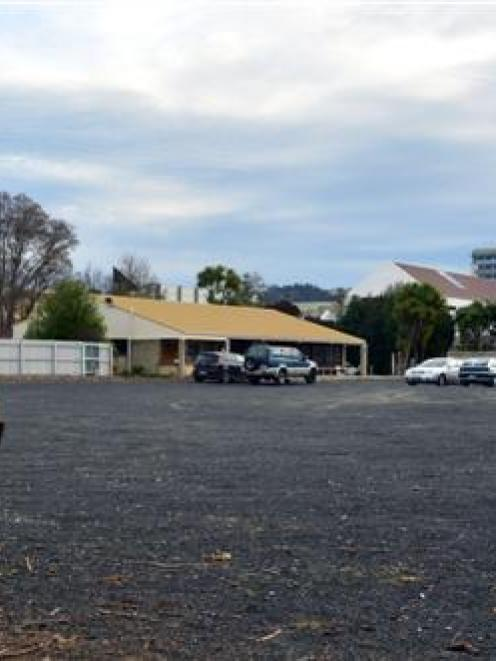 The gravel car park, viewed from the edge of Logan Park looking towards Otago Polytechnic, that...