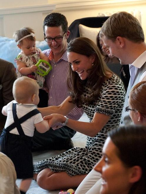 The heir to the British throne meets New Zealand children during a playdate held at Government...