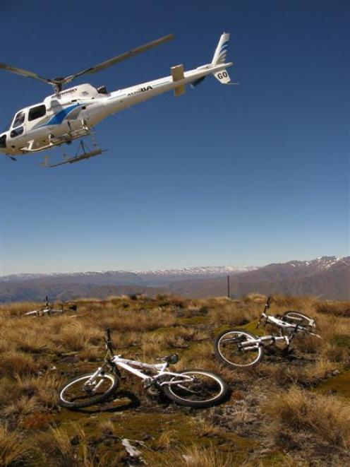 The helicopter that brought us up Crown Peak with our bikes departs for Queenstown Airport....