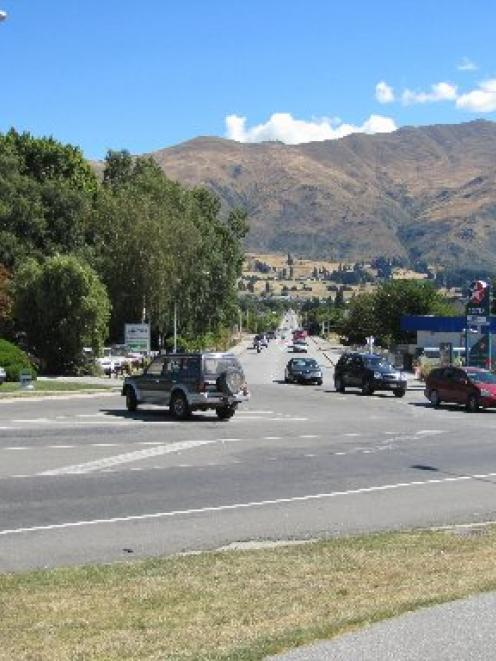 The intersection of Ardmore and Brownston Sts in Wanaka, looking down Brownston St. A roundabout...
