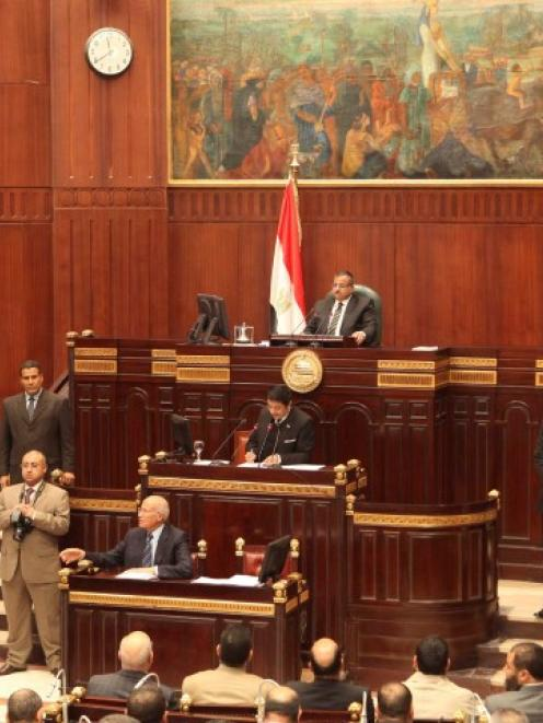 The Islamist-dominated upper house of parliament (Shura Council) holds a meeting under Eqypt's...