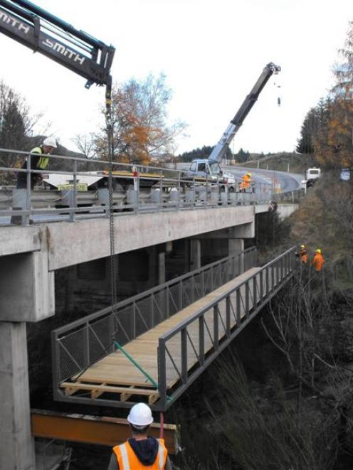 The linking cycle bridge for the Queenstown Trail was put in place on Friday morning, at the...