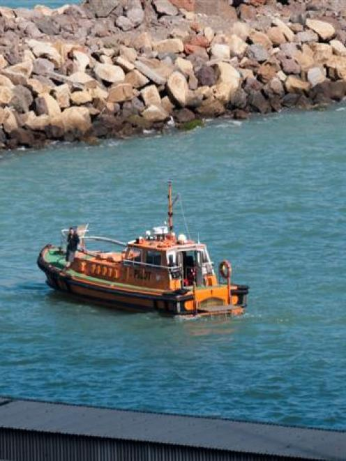 The LPC Pilot boat assists divers near the cruise ship Volendam which lost two crew members...