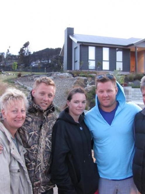 The McCarroll family of Hong Kong were relieved their holiday home was not harmed. From left,...
